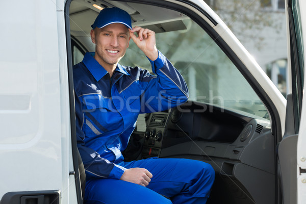 Portrait Of Happy Technician Sitting In Van Stock photo © AndreyPopov