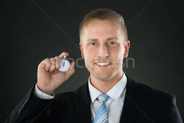 Businessman Holding Stopwatch In His Hand Stock photo © AndreyPopov