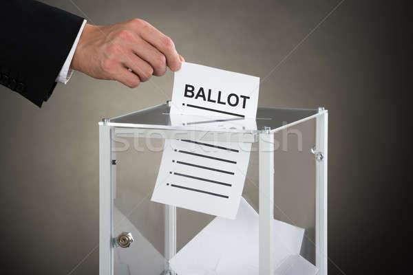 Işadamı el oylama cam kutu Stok fotoğraf © AndreyPopov