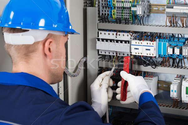 Male Electrician Repairing Fusebox Stock photo © AndreyPopov