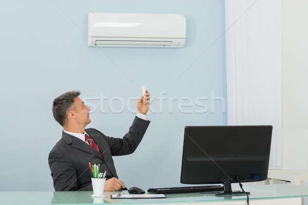 Maduro empresário ar condicionado escritório feliz sessão Foto stock © AndreyPopov