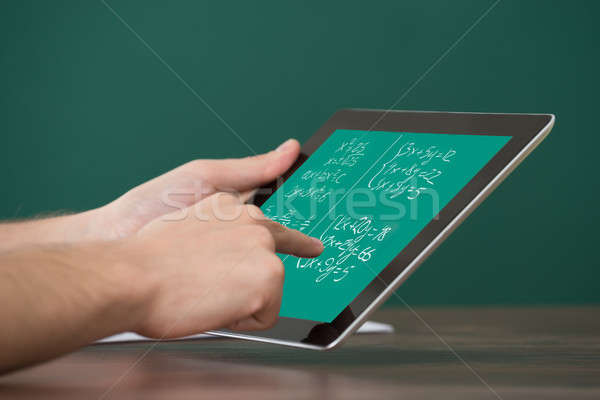 Man Learning Mathematical Equations On Digital Tablet Stock photo © AndreyPopov