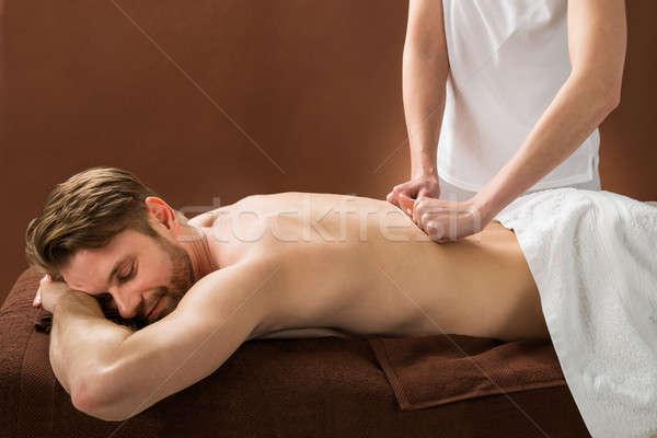 молодым человеком назад массаж Spa портрет Сток-фото © AndreyPopov