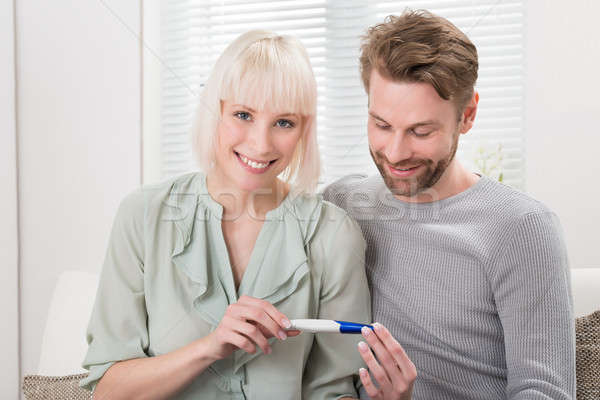 Couple Holding Pregnancy Tester Stock photo © AndreyPopov