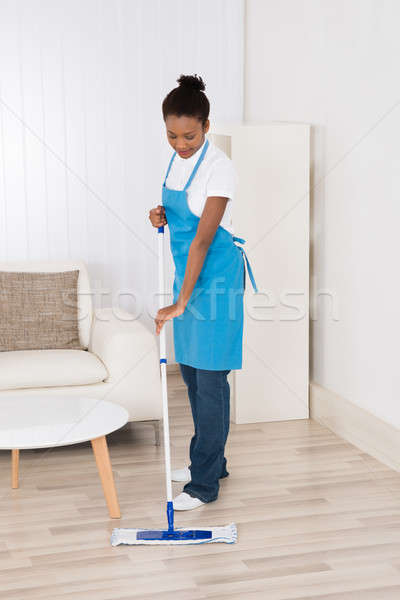 Female Janitor Mopping Floor Stock photo © AndreyPopov
