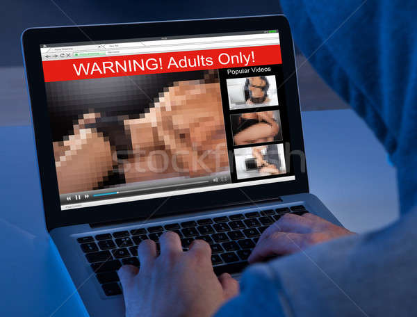 Person Watching Adult Movie On Laptop Stock photo © AndreyPopov