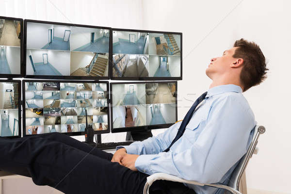 Security Guard Sleeping In Control Room Stock photo © AndreyPopov
