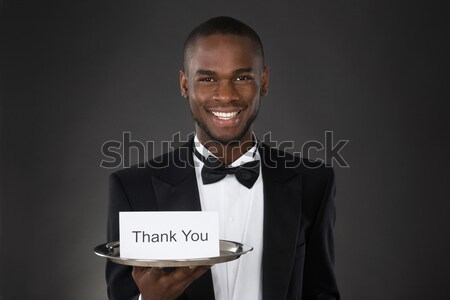 Waiter Holding Plate With Star Rating Stock photo © AndreyPopov