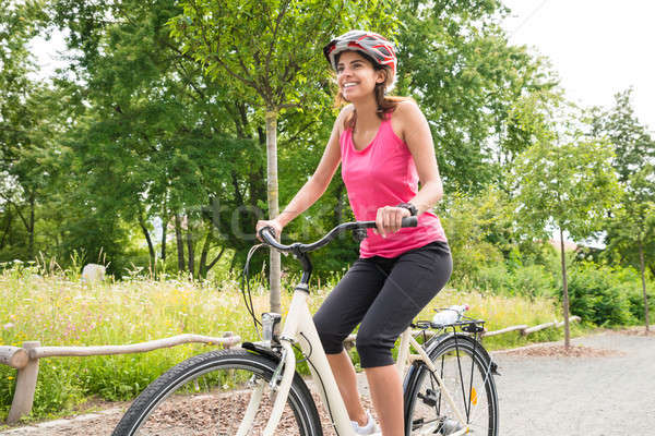 Young Woman Enjoying Ride On Bicycle Stock photo © AndreyPopov