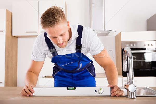 Idraulico livello sink maschio cucina Foto d'archivio © AndreyPopov