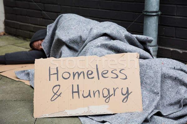 Bezdomnych głodny człowiek snem ulicy życia Zdjęcia stock © AndreyPopov