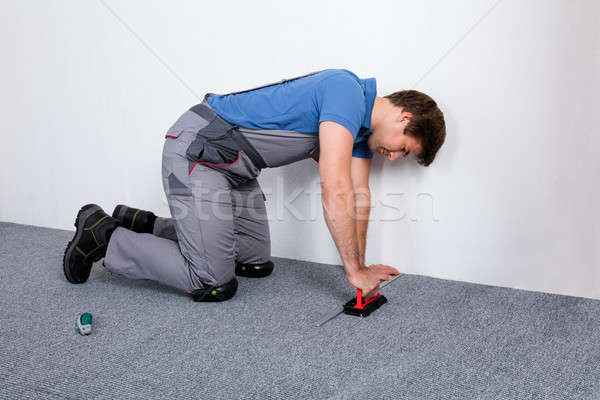 Munkás átfogó szőnyeg férfi ács szerszámok Stock fotó © AndreyPopov
