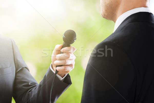 репортер интервью бизнесмен телевидение микрофона Сток-фото © AndreyPopov