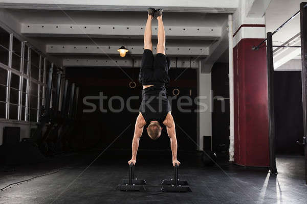 Man Doing Handstand On Parallel Bar Stock photo © AndreyPopov