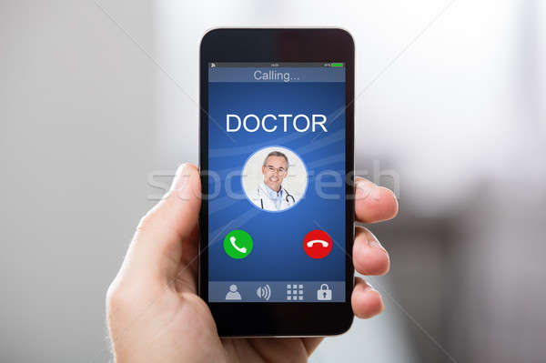 Doctor's Incoming Call On Smartphone Stock photo © AndreyPopov