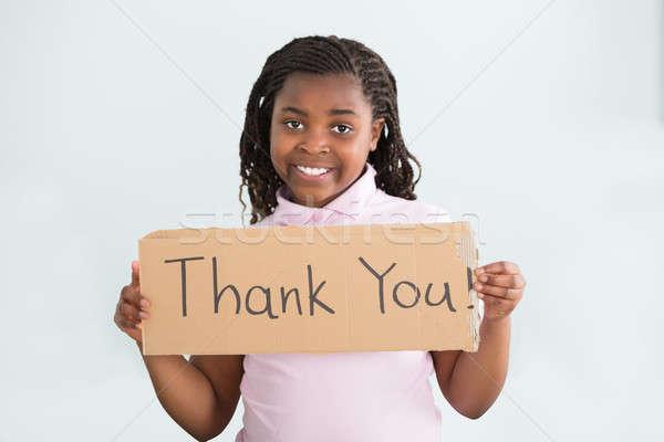 Lány tart köszönjük felirat közelkép mosolyog Stock fotó © AndreyPopov