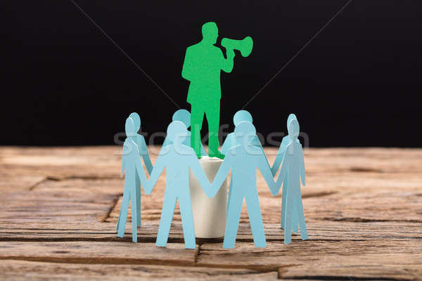 Businessman Speaking Through Megaphone Surrounded By Team Stock photo © AndreyPopov