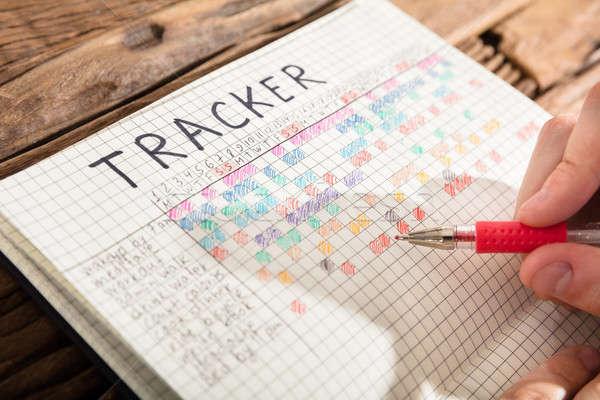 Személy rajz diagram notebook közelkép személyek Stock fotó © AndreyPopov