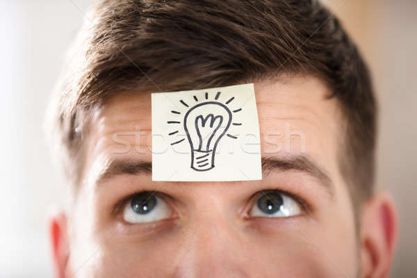 Close-up Of A Businessperson's Forehead With Idea Concept Stock photo © AndreyPopov