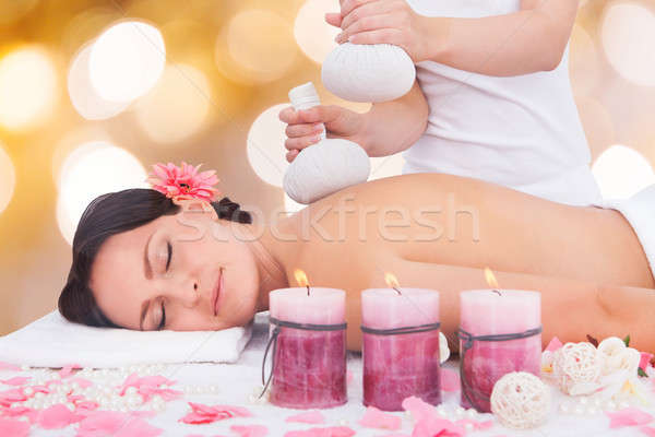Woman Receiving Massage With Herbal Compress Balls Stock photo © AndreyPopov