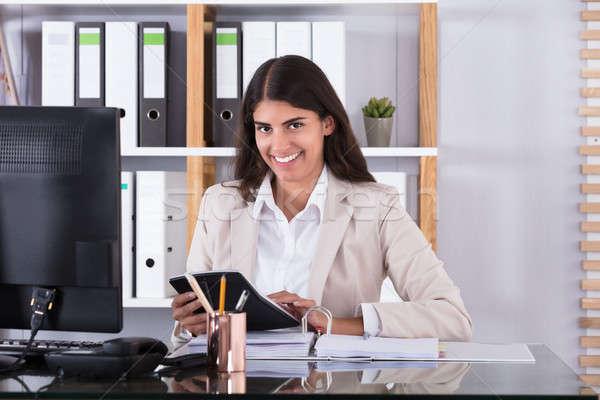 幸せ 女性実業家 金融 データ 肖像 電卓 ストックフォト © AndreyPopov