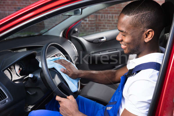Male Worker Cleaning Steering Wheel Stock photo © AndreyPopov