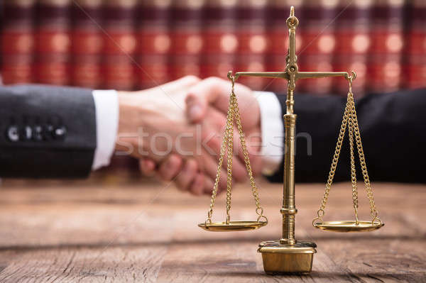 Close-up Of Justice Scale On Wooden Desk Stock photo © AndreyPopov