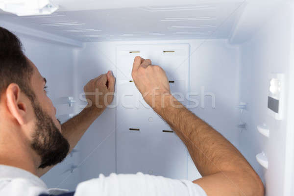 Electrician Fixing Refrigerator In Kitchen Stock photo © AndreyPopov