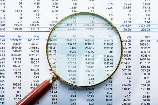 Magnifying Glass On Financial Report Stock photo © AndreyPopov