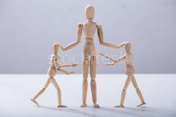 Wooden Dummy Caring For Child Dummy Stock photo © AndreyPopov