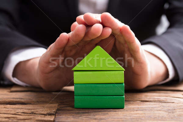 Close-up Of A Businessperson Protecting House Model Stock photo © AndreyPopov
