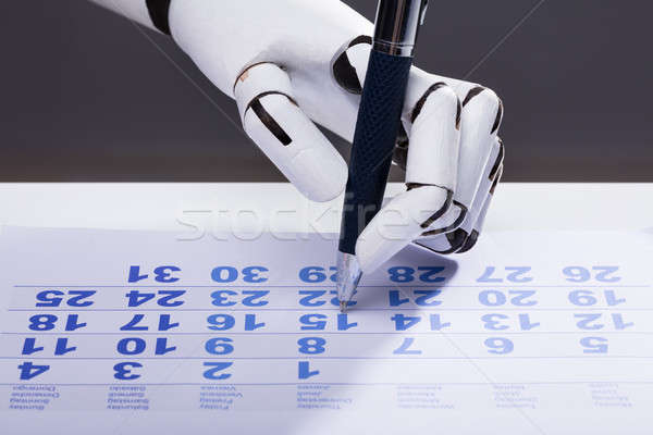 Robot date calendrier robotique main Photo stock © AndreyPopov