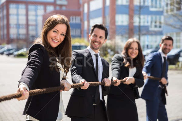 Businesspeople Playing Tug Of War Stock photo © AndreyPopov