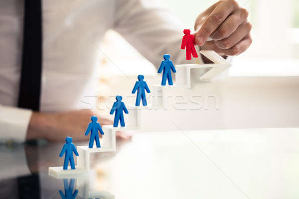 Businessperson Picking Red Human Figure Stock photo © AndreyPopov