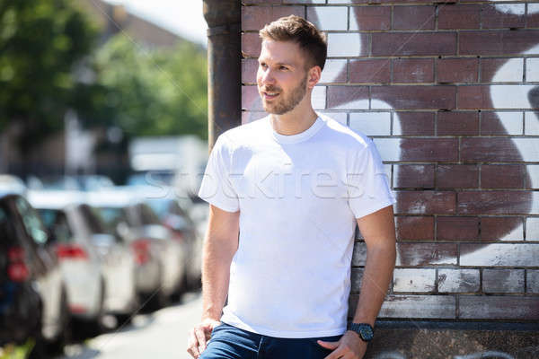 Man Leaning On Brick wall Stock photo © AndreyPopov