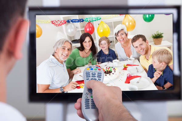 Man changing television channel through remote Stock photo © AndreyPopov