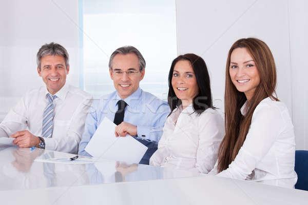 Boldog üzletemberek csetepaté portré ül üzlet Stock fotó © AndreyPopov
