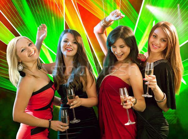 Stylish women toasting with champagne Stock photo © AndreyPopov