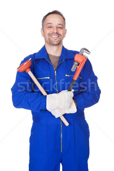 Happy Plumber Holding Plunger And Wrench Stock photo © AndreyPopov