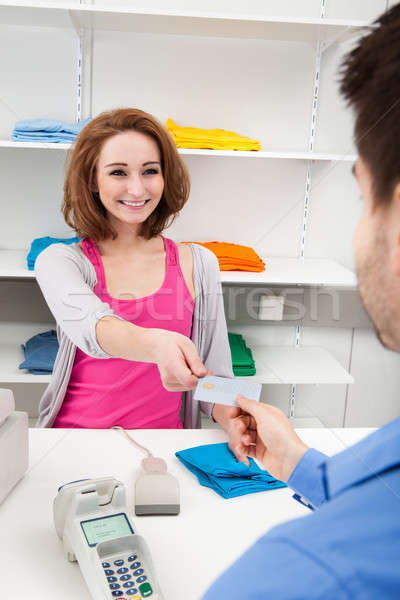 Client Handing Over Credit Card To A Cashier Stock photo © AndreyPopov