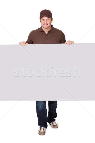 Postbode presenteren lege banner geïsoleerd witte Stockfoto © AndreyPopov
