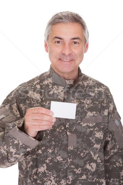 зрелый солдата чистый лист бумаги изолированный белый Сток-фото © AndreyPopov