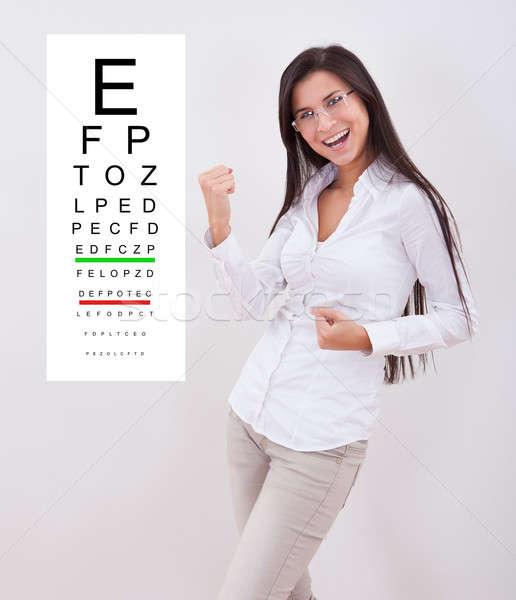 Hölgy új szemüveg áll látásvizsgálat diagram Stock fotó © AndreyPopov