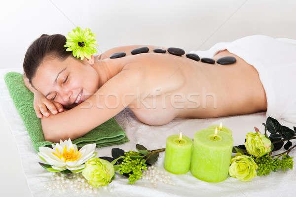 Woman Getting Lastone Massage Stock photo © AndreyPopov