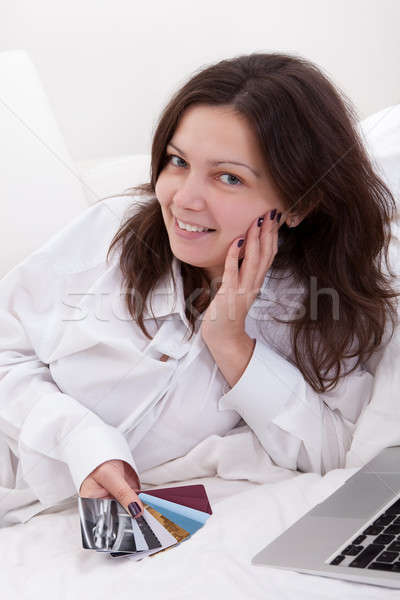 Woman contemplating her credit cards Stock photo © AndreyPopov