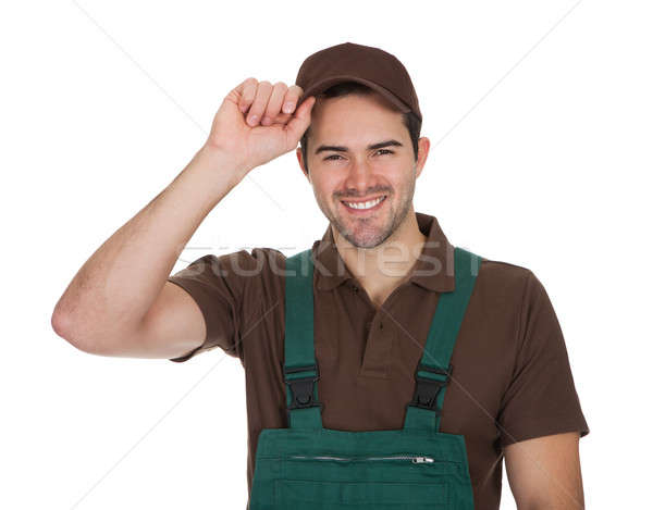 Happy young gardener in dungarees Stock photo © AndreyPopov