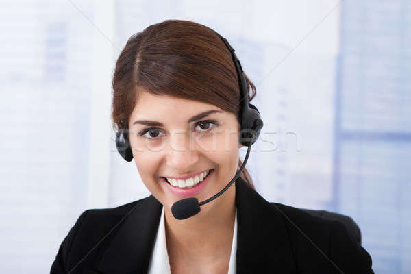 Confident Businesswoman Wearing Headset In Office Stock photo © AndreyPopov