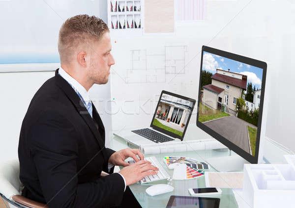 Businessman checking a property portfolio online Stock photo © AndreyPopov