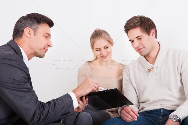 Consultant Showing Clipboard To Couple Stock photo © AndreyPopov