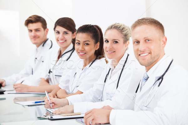 Confident Doctors Sitting In A Row Stock photo © AndreyPopov
